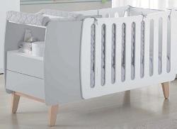 Cuna convertible en cama con cambiador